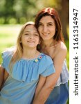 happy mother and daughter... | Shutterstock . vector #1161314947