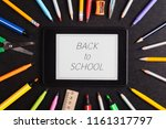a school supplies on blackboard  | Shutterstock . vector #1161317797