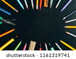 a school supplies on blackboard  | Shutterstock . vector #1161319741
