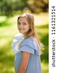 beautiful young girl enjoying... | Shutterstock . vector #1161321514