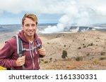 hawaii volcano tourist man at... | Shutterstock . vector #1161330331