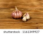 onion and a pair of garlic... | Shutterstock . vector #1161349927
