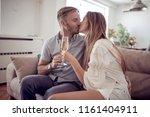 beautiful couple is drinking... | Shutterstock . vector #1161404911