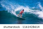 riding the waves. costa rica ... | Shutterstock . vector #1161428614