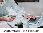 business woman hand using... | Shutterstock . vector #1161484684