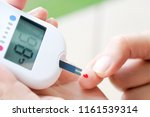 hand of people check diabetes... | Shutterstock . vector #1161539314