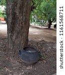 bin infront of the tree in park   Shutterstock . vector #1161568711