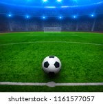 soccer ball on green stadium ... | Shutterstock . vector #1161577057