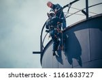 male worker rope access ... | Shutterstock . vector #1161633727