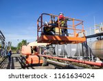 two male  industry working at... | Shutterstock . vector #1161634024