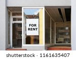 for rent vacancy sign in shop... | Shutterstock . vector #1161635407