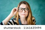 young female student looking...   Shutterstock . vector #1161635494