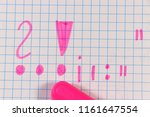 Small photo of A Punctuation Marks writing by pink pen on square paper in school for learning new things. Do you know them