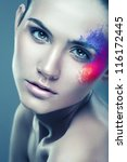 girl with coloured powder above eye - stock photo