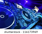 Dj Mixes The Track In The...