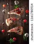 levitating pizza and vegetables.... | Shutterstock . vector #1161780514