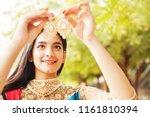beautiful indian woman looking... | Shutterstock . vector #1161810394