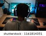 back view of teenage gamer boy... | Shutterstock . vector #1161814351