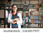 teenage smart girl in glasses... | Shutterstock . vector #1161817957
