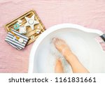 taking a magnesium footbath for ... | Shutterstock . vector #1161831661