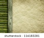 Template background - old handmade paper sheet and bamboo - stock photo