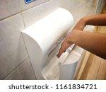 female dries wet hand in modern ... | Shutterstock . vector #1161834721