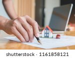 pen handles signed documents... | Shutterstock . vector #1161858121