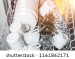 an open dishwasher with clean... | Shutterstock . vector #1161862171