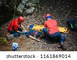 search and rescue team helping... | Shutterstock . vector #1161869014