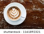 top view white cup of coffee on ... | Shutterstock . vector #1161892321