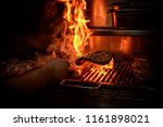 big piece of meat being grilled ... | Shutterstock . vector #1161898021
