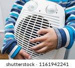 young boy in warm winter... | Shutterstock . vector #1161942241