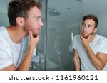 man face care looking in mirror ... | Shutterstock . vector #1161960121