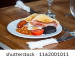 english breakfast with sausage  ...   Shutterstock . vector #1162001011