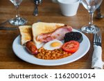 english breakfast with sausage  ... | Shutterstock . vector #1162001014