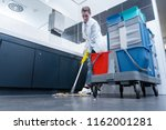 cleaning lady mopping the floor ... | Shutterstock . vector #1162001281