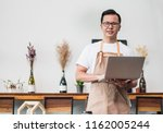 asian male barista cafe owner... | Shutterstock . vector #1162005244