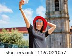 young beautiful girl in red hat ... | Shutterstock . vector #1162021057