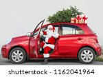 authentic santa claus in car... | Shutterstock . vector #1162041964