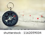 magnetic compass on world map... | Shutterstock . vector #1162059034