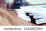 stack of documents placed on a... | Shutterstock . vector #1162065244