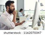 handsome pensive entrepreneur... | Shutterstock . vector #1162070347