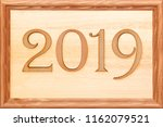 wooden numbers 2019 in a brown... | Shutterstock . vector #1162079521