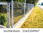 grating wire industrial fence... | Shutterstock . vector #1162104967