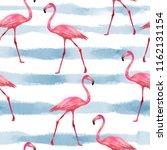 seamless flamingos pattern ... | Shutterstock . vector #1162131154