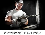 man with a tool. worker using a ... | Shutterstock . vector #1162149037