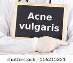 Small photo of Doctor shows information on blackboard: acne vulgaris