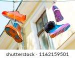color footwear hangs against... | Shutterstock . vector #1162159501
