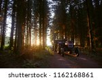 small tractor with trailer full ... | Shutterstock . vector #1162168861