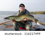 happy angler with pike fishing... | Shutterstock . vector #116217499